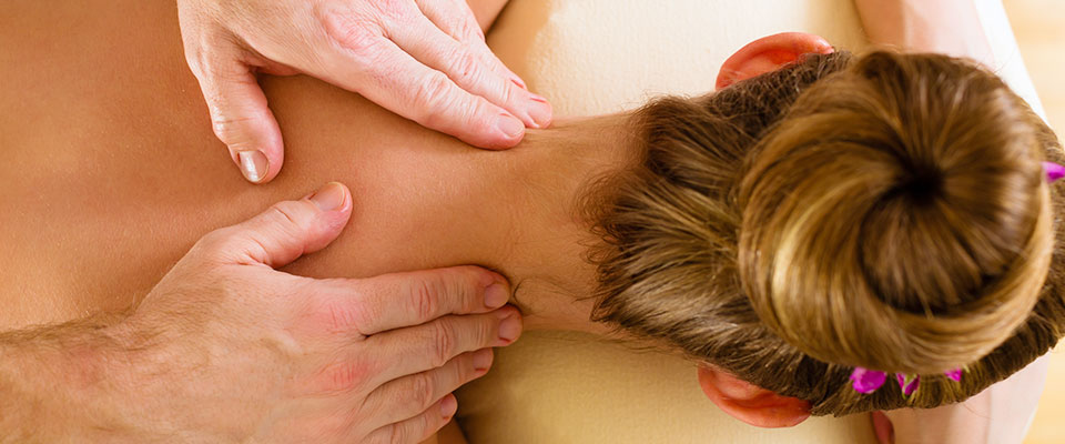 Massage therapist giving a massage in Hamilton